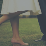 couple getting married, image only shows feet and legs, symbolizing the foundation of a solid marriage