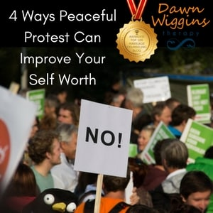 people demonstrating, one person holds a NO sign up, 4 ways peaceful protest can improve your self worth