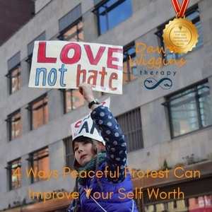 child protesting, holding up a sign LOVE not hate, 4 ways peaceful protest can improve your self worth