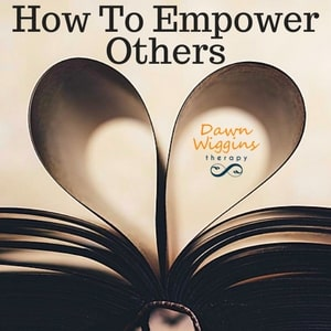 open book where two pages shape a heart, symbolizing how to empower others