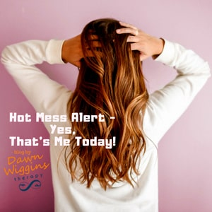 frustrated woman straightens her hair while she gathers herself for her next task, hot mess alert, yes, that's me today