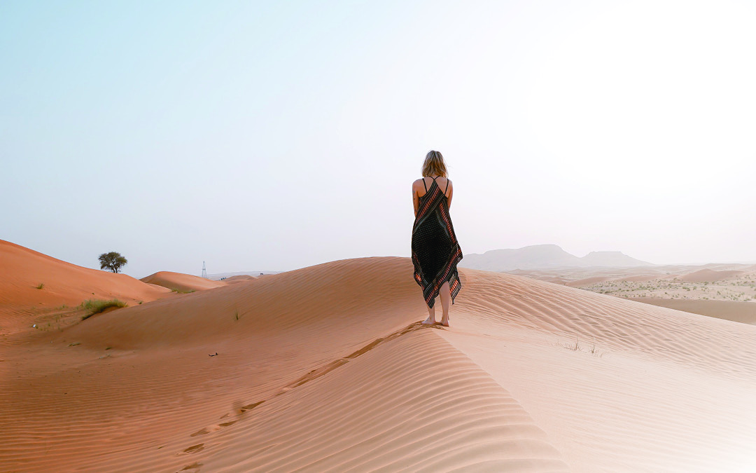 a woman with short hair and long dress, walking in the desert, how to overcome trust issues in relationships